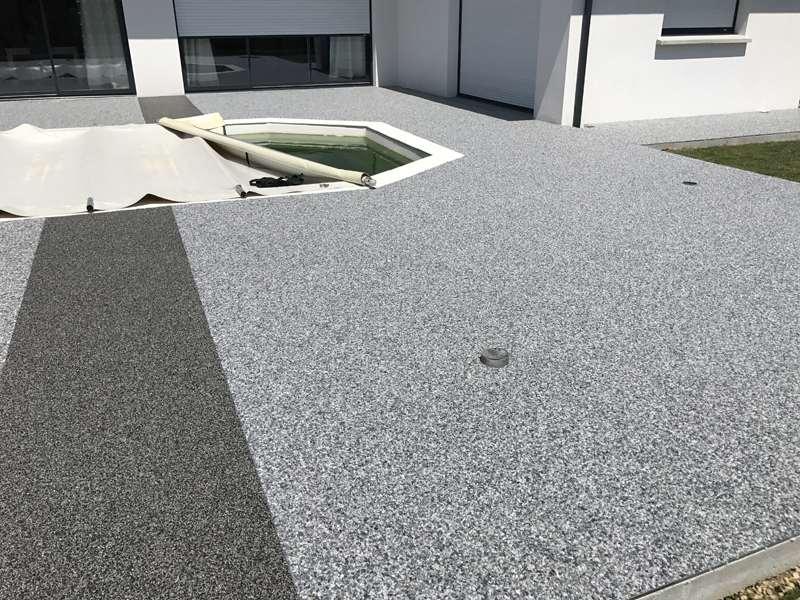 Sol revetement granulat de marbre resine terrasse plage de piscine